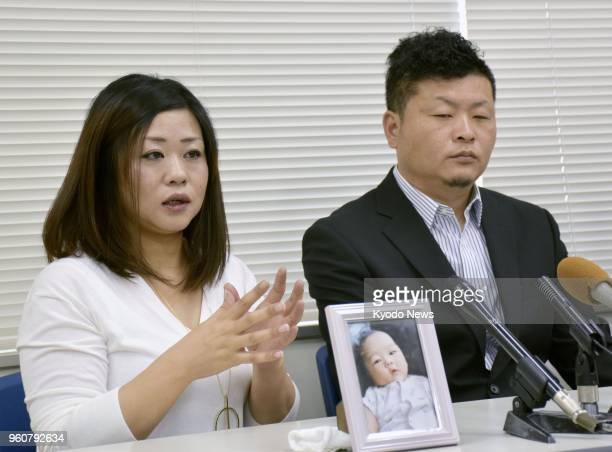 Masami Kitano and his wife Megumi hold a press conference in Kobe on May 21 as they file a damages lawsuit against a funeral company for emotional...
