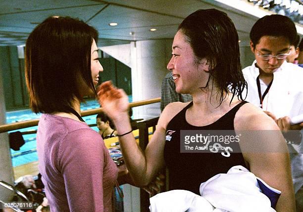 Masami Tanaka is interviewed by Barcelona Olympic gold medalist Kyoko Iwasaki during the 76th All Japan Swimming Championships at Tokyo Tatsumi...