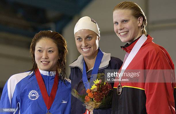 Masami Tanaka of Japan silver Amanda Beard of USA gold and Emma Igelstrom of Sweden bronze pose on the podium after the women's 200m breast stroke...