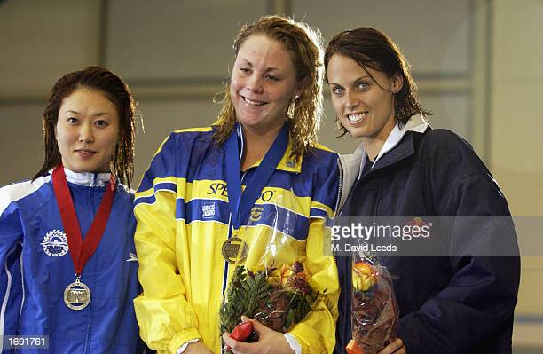Masami Tanaka of Japan silver Emma Igelstrom of Sweden first place and Amanda Beard of USA wins the bronze medal in the Women's 100m breast stroke...
