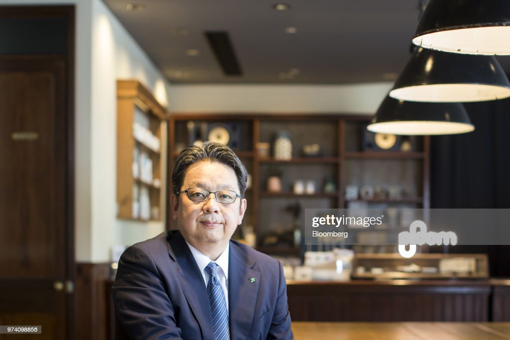 Masamichi Terabatake, president and chief executive officer of Japan Tobacco Inc., poses for a photograph in a smoking lounge at the company's headquarters in Tokyo, Japan, on Wednesday, June 13, 2018. Japans impending tax increase on traditional cigarettes may rekindle its stalled market for smokeless devices, according to Terabatake. Photographer: Tomohiro Ohsumi/Bloomberg via Getty Images