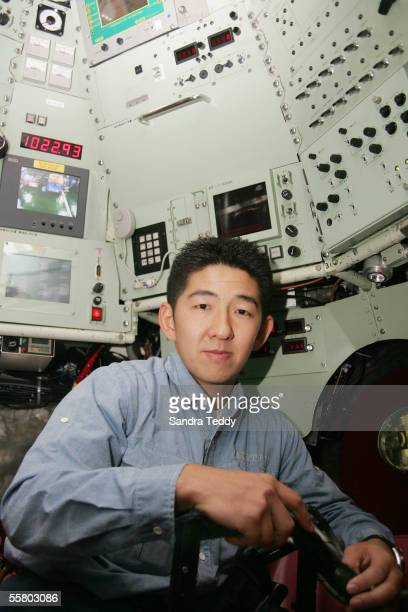 """Masanobu Yanagitani, one of two pilots that steer this machine to the bottom of the sea, is photographed inside the cockpit of """"Shinkai 6500"""" aboard..."""