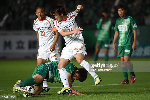 Masanori Abe of FC Gifu keeps the ball under the pressure from Daichi Akiyama of Ehime FC during the JLeague second division match between FC Gifu...