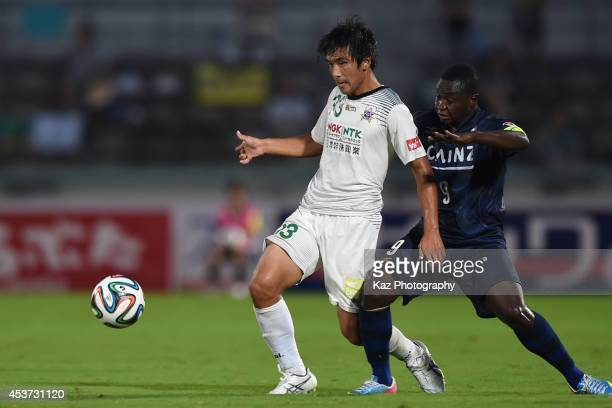Masanori Abe of FC Gifu wins the ball under the pressure from Daniel Lovinho of Thespakusatsu Gunma during the J League 2nd division match between...
