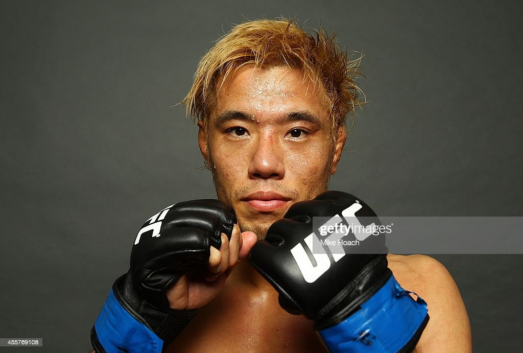 Masanori Kanehara poses for a photo after his win backstage during the UFC Fight Night event inside the Saitama Arena on September 20, 2014 in Saitama, Japan.