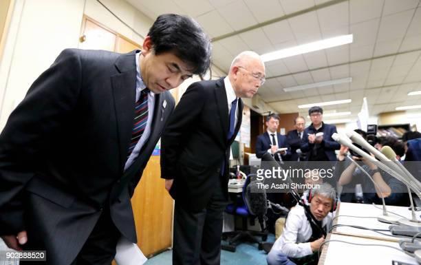 Masanori Narita President of the Japan Canoe Federation bows during a press conference on January 9 2018 in Tokyo Japan 32yearold Yasuhiro Suzuki...