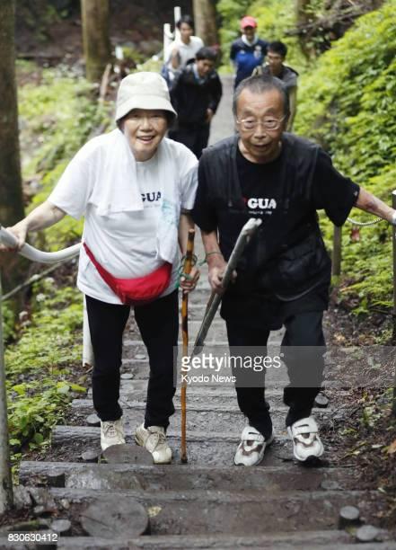 Masanori Takishita and his wife Fumiyo from Tokyo climb a mountain in Gunma Prefecture northwest of Tokyo toward Osutaka Ridge on Aug 12 the 32nd...