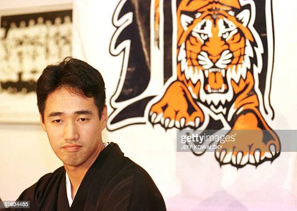 Masao Kida listens to a question from a reporter in Detroit MI 09 December after he signed a contract to play for the Detroit Tigers Kida a...