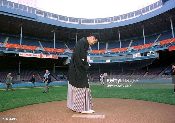 Masao Kida looks down at the pitcher's mound at the Tigers' Stadiun in Detroit MI 09 December after he signed a contract to play for the Detroit...