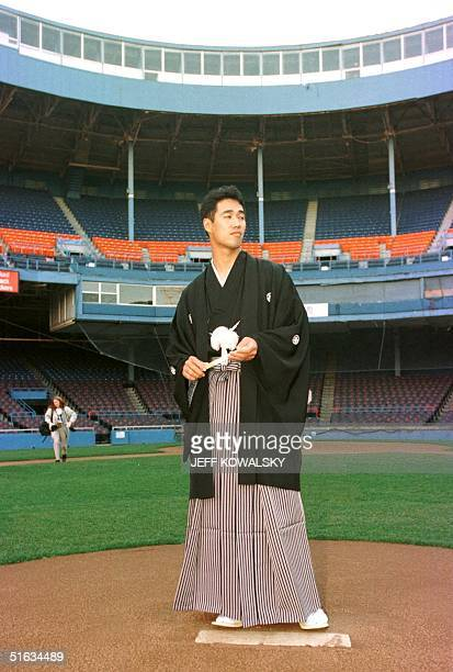 Masao Kida stands on the pitchers' mound at Tigers Stadium in Detroit MI 09 December after he signed a contract to play for the Detroit Tigers Kida a...