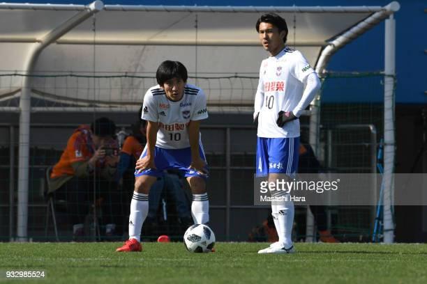 Masaru Kato and Yoshizumi Ogawa of Albirex Niigata look on during the JLeague J2 match between Yokohama FC and Albirex Niigata at Nippatsu Mitsuzawa...