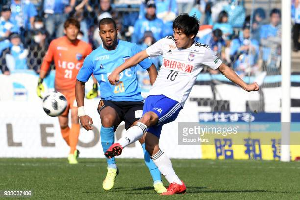 Masaru Kato of Albirex Niigata and Calvin Jong A Pin of Yokohama FC compete for the ball during the JLeague J2 match between Yokohama FC and Albirex...