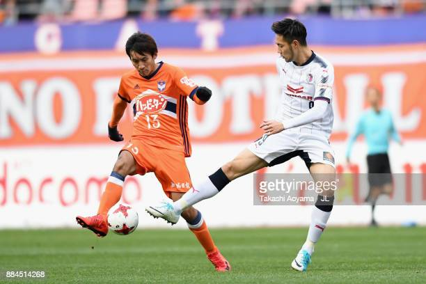 Masaru Kato of Albirex Niigata and Kenyu Sugimoto of Cerezo Osaka compete for the ball during the JLeague J1 match between Albirex Niigata and Cerezo...