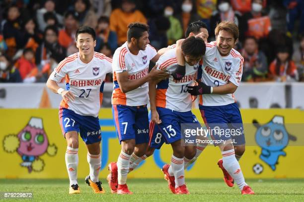 Masaru Kato of Albirex Niigata celebrates scoring his side's second goal with his team mates during the JLeague J1 match between Shimizu SPulse and...