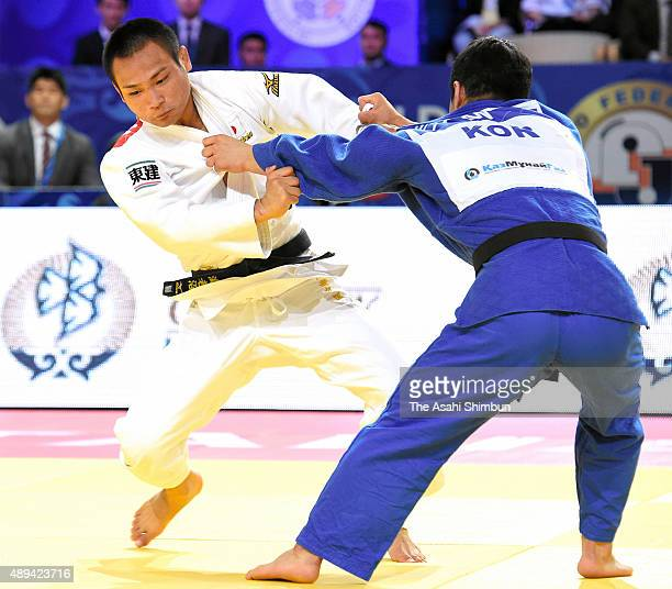 Masashi Ebinuma of Japan and An Baul of South Korea compete in the Men's team final during the 2015 Astana World Judo Championships at the Alau Ice...