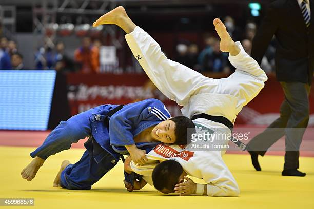 Masashi Ebinuma of Japan and Baul An of Korea compete in Men's 66kg during Judo Grand Slam Tokyo 2014 at Tokyo Metropolitan Gymnasium on December 5...