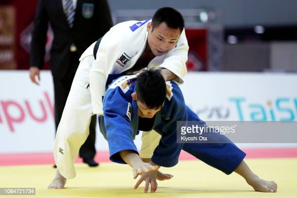 Masashi Ebinuma of Japan competes against Shohei Ono of Japan in the Men's 73kg final match on day two of the Grand Slam Osaka at Maruzen Intec Arena...