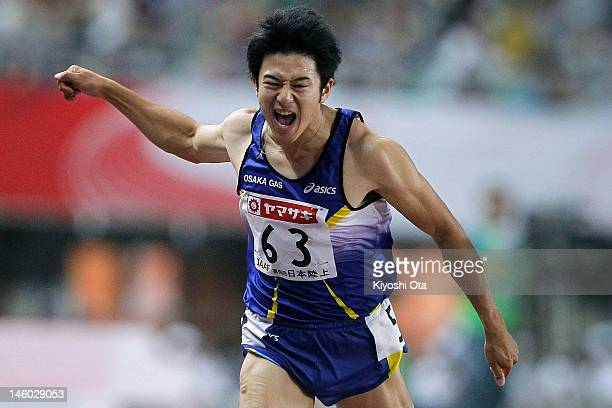 Masashi Eriguchi of Japan reacts as he crosses the finish line to win the Men's 100m final during day two of the 96th Japan National Championships at...