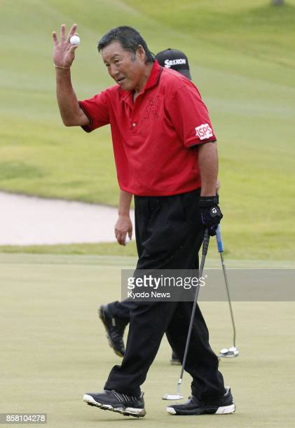 Masashi 'Jumbo' Ozaki acknowledges the gallery after shooting his age in the second round of the Honma Tourworld Cup a regular Japanese professional...