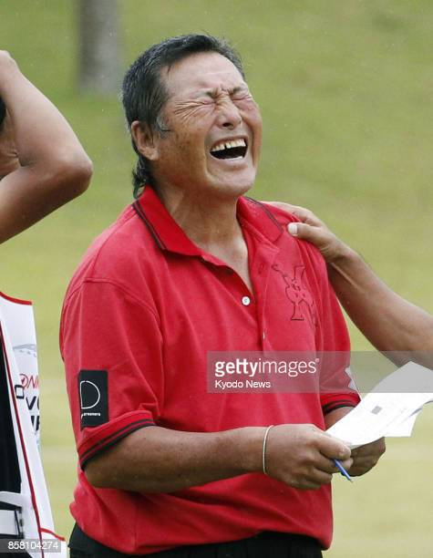 Masashi 'Jumbo' Ozaki reacts after shooting his age in the second round of the Honma Tourworld Cup a regular Japanese professional golf tour event at...