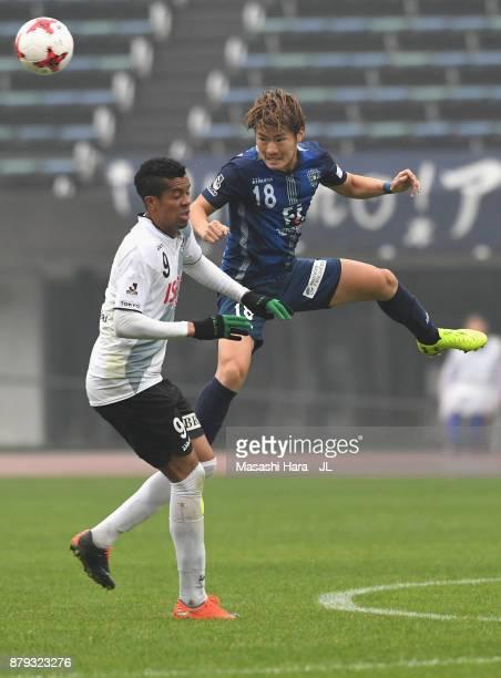Masashi Kamekawa of Avispa Fukuoka and Douglas Vieira of Tokyo Verdy compete for the ball during the JLeague J1 Promotion PlayOff semi final match...