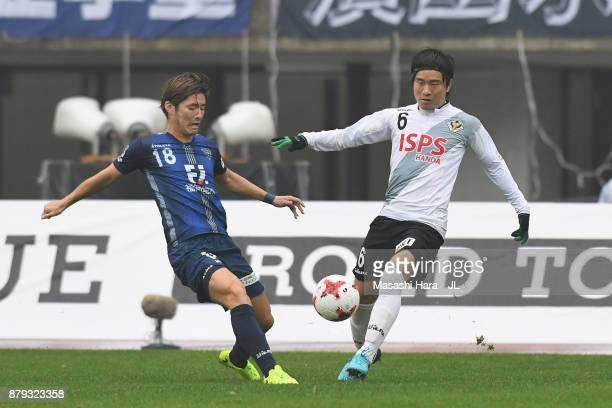 Masashi Kamekawa of Avispa Fukuoka and Kazuki Anzai of Tokyo Verdy compete for the ball during the JLeague J1 Promotion PlayOff semi final match...