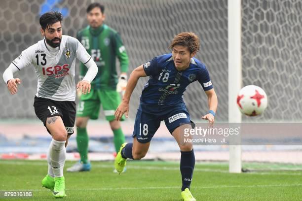 Masashi Kamekawa of Avispa Fukuoka controls the ball under pressure of Carlos Martinez of Tokyo Verdy during the JLeague J1 Promotion PlayOff semi...