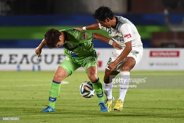 Masashi Kamekawa of Shonan Bellmare keeps the ball under the pressure from Yusuke Mori of FC Gifu during the J League second division match between...