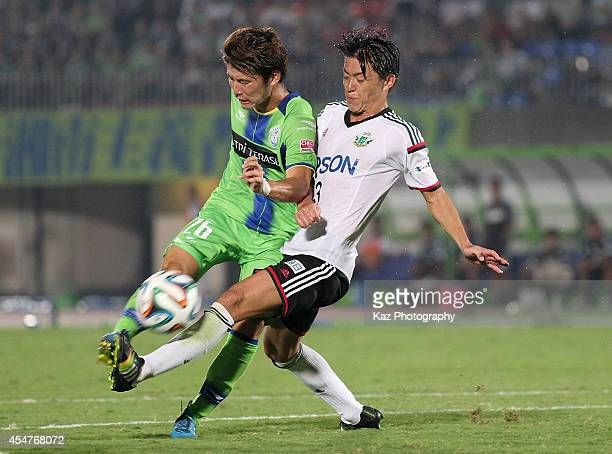Masashi Kameyama of Shonan Bellmare and Hayuma Tanaka of Matsumoto Yamaga compete for the ball during the JLeague second division match between...