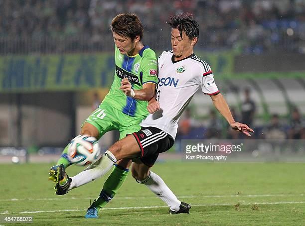Masashi Kameyama of Shonan Bellmare and Hayuma Tanaka of Matsumoto Yamaga compete for the ball during the J.League second division match between...