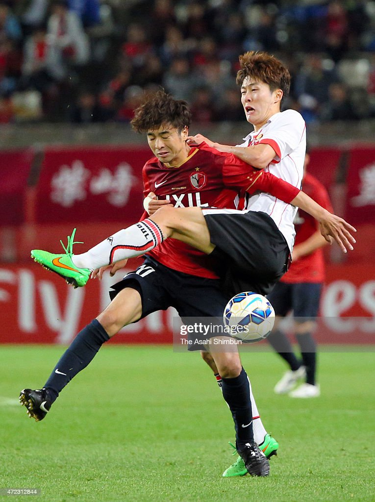 Masashi Motoyama of Kashima Antlers and Koh Myongjin of FC Seoul compete for the ball during the AFC Champions League Group H match between Kashima Antlers and FC Seoul at Kashima Stadium on May 5, 2015 in Kashima, Ibaraki, Japan.