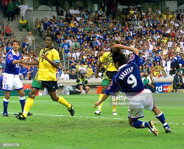 Masashi Nakayama scores his team's first goal during the FIFA World Cup France Group H match between Japan and Jamaica at Stade de Gerland on June 26...