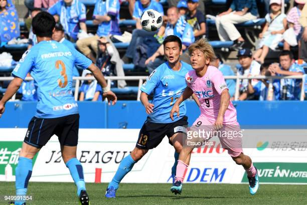Masashi Oguro of Tochigi SC and Bae Seung Jin of Yokohama FC compete for the ball during the JLeague J2 match between Yokohama FC and Tochigi SC at...