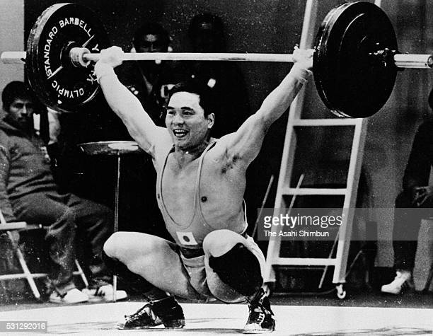 Masashi Ouchi of Japan competes in the Weightlifting Middleweight during the Mexico City Summer Olympic Games at Insurgentes Theatre on October 16...
