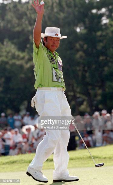 Masashi Ozaki of Japan celebrates winning after holing a birdie putt on the 18th green during the final round of the HisamitsuKBC Augusta at Keya...