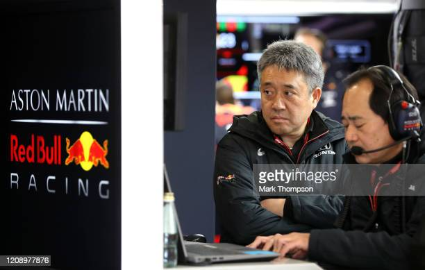 Masashi Yamamoto of Honda and Toyoharu Tanabe of Honda look on in the Red Bull Racing garage during Day Two of F1 Winter Testing at Circuit de...