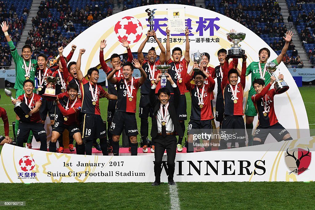 Masatada Ishii of Kashima Antlers lifts the Cup after the 96th Emperor's Cup final match between Kashima Antlers and Kawasaki Frontale at Suita City Football Stadiumon January 1, 2017 in Suita, Osaka, Japan.