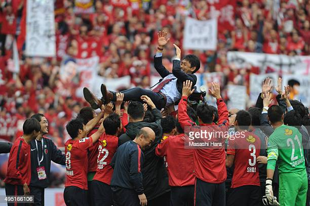 Masatada Ishiicoach of Kashima Antlers is tossed by players after the JLeague Yamazaki Nabisco Cup final match between Kashima Antlers and Gamba...
