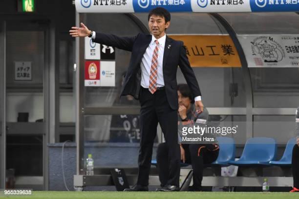 Masatada Ishiicoach of Omiya Ardija looks on during the JLeague J2 match between Omiya Ardija and JEF United Chiba at Nack 5 Stadium Omiya on May 6...