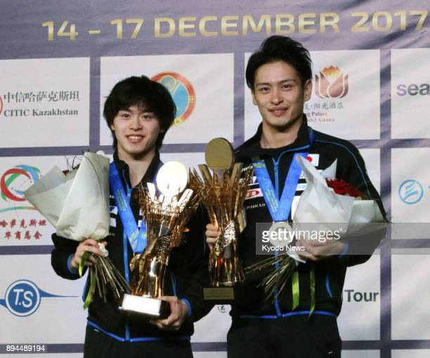 Masataka Morizono and Yuya Oshima pose with their trophies after winning the men's doubles final at the World Tour Grand Finals in Astana Kazakhstan...