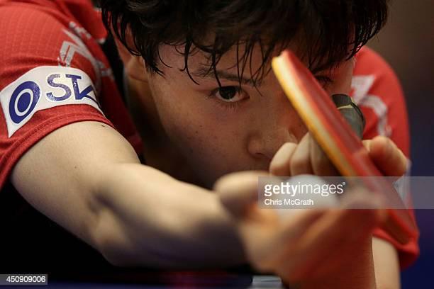 Masataka Morizono of Japan serves against Mattias Karlsson of Sweden during their Men's Singles match on day one of 2014 ITTF World Tour Japan Open...