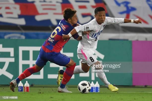 Masato Fujita of Sagan Tosu and Kosuke Ota of FC Tokyo compete for the ball during the JLeague J1 match between FC Tokyo and Sagan Tosu at Ajinomoto...