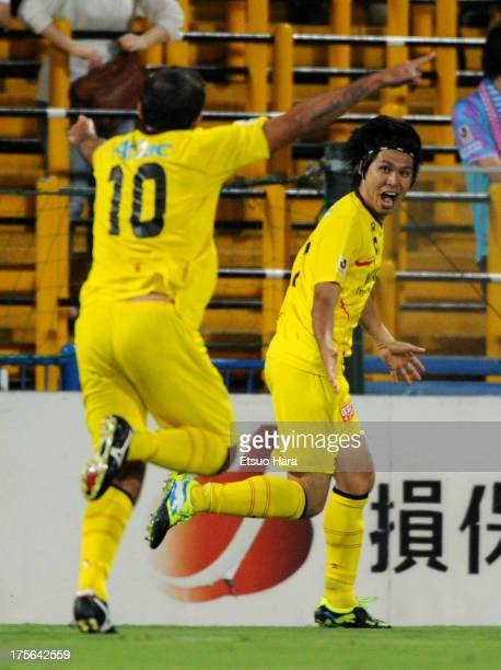 Masato Kudo of Kashiwa Reysol celebrates scoring his team's first goal with his team mate Leandro Domingues during the J.League match between Kashiwa...