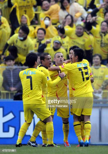 Masato Kudo of Kashiwa Reysol celebrates scoring his team's first goal with his teammates during the J League match between Kashiwa Reysol and FC...