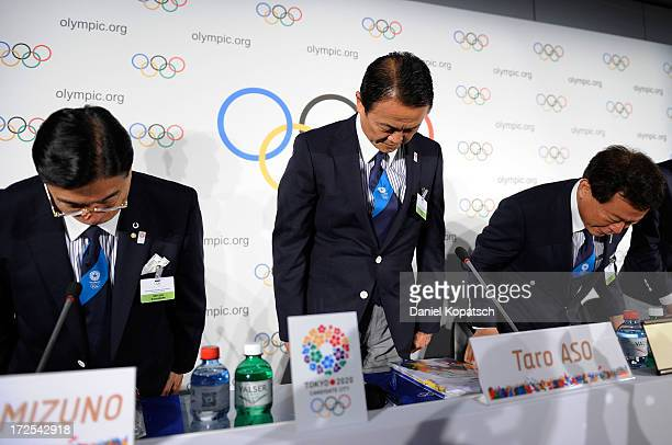 Masato Mizuno CEO of Tokyo 2020 Taro Aso Finance and Deputy Prime Minister and Naoki Inose Governor of Tokyo arrive for a press conference during the...