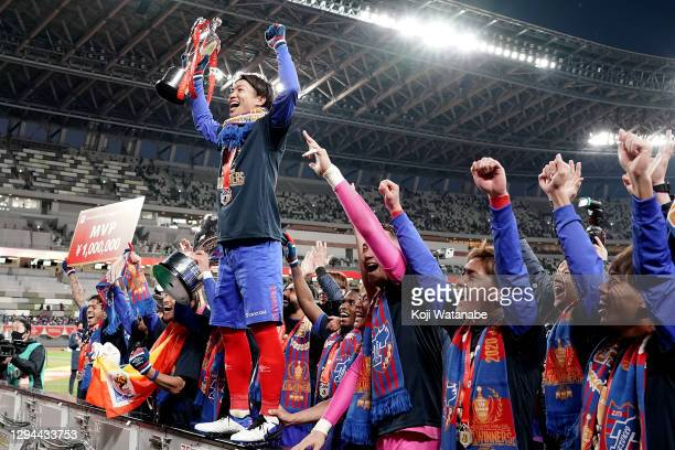 Masato Morishige of FC Tokyo lifts the trophy as they celebrate after the J.League YBC Levain Cup final between Kashiwa Reysol and FC Tokyo at the...