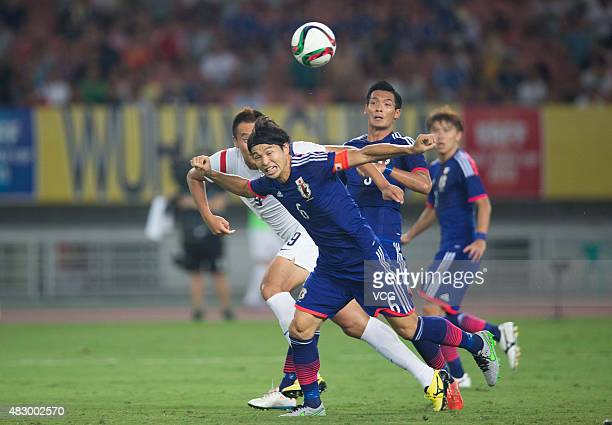 Masato Morishige of Japan vies for the ball in group match between Japan and South Korea during EAFF East Asian Cup 2015 at Wuhan Sports Center...
