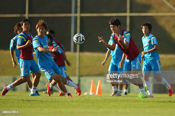 Masato Morishige passes during a drill at a Japan training session at the Japan national team base camp at the Spa Sport Resort on June 11 2014 in...
