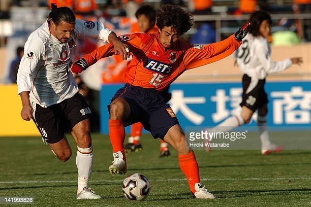 Masato Saito of Omiya Ardija and Tomislav Maric of Urawa Red Diamonds compete for the ball during the 85th Emperor's Cup semi final match between...