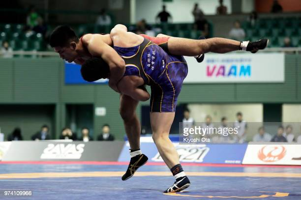 Masato Sumi competes against Taichi Oka in the Men's GrecoRoman style 87kg final on day one of the All Japan Wrestling Invitational Championships at...